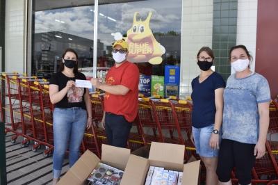 Escola Paulo Freire recebe troco solidário do Supermercado Beviláqua